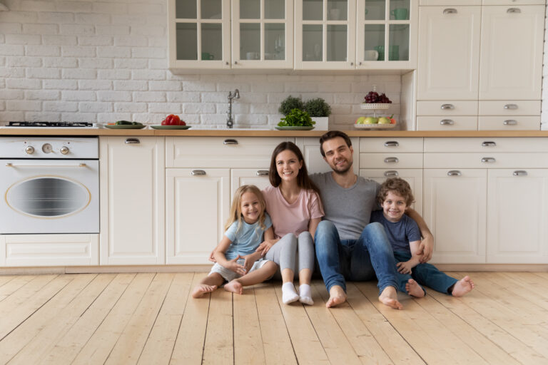 Family sitting on kitchen floor