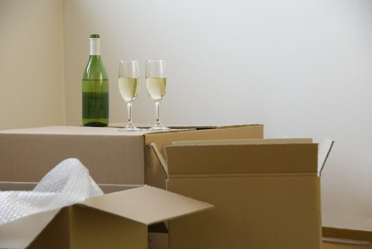 Two wine glasses on a moving box